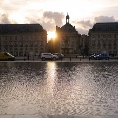 Sunset in Place de la Bourse