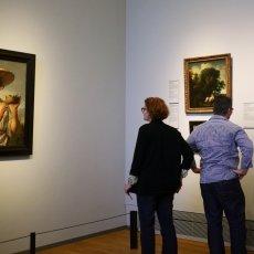 People admiring paintings