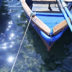 Boat and sun reflections