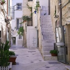 The streets of Polignano are decorated with poems