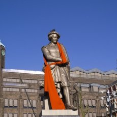 Rembrandt statue dressed in orange
