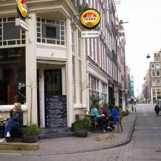 People relaxing at a small corner cafe in Jordaan
