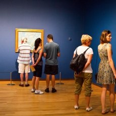 People admiring the paintings