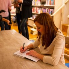 Vicky signing books
