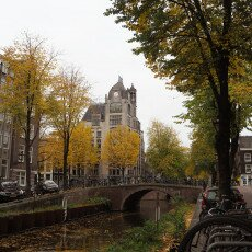 Amsterdam in yellow coat 07