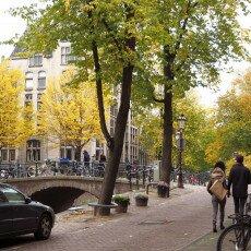 Amsterdam in yellow coat 08