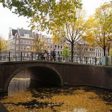 Amsterdam in yellow coat 09