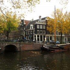 Amsterdam in yellow coat 26