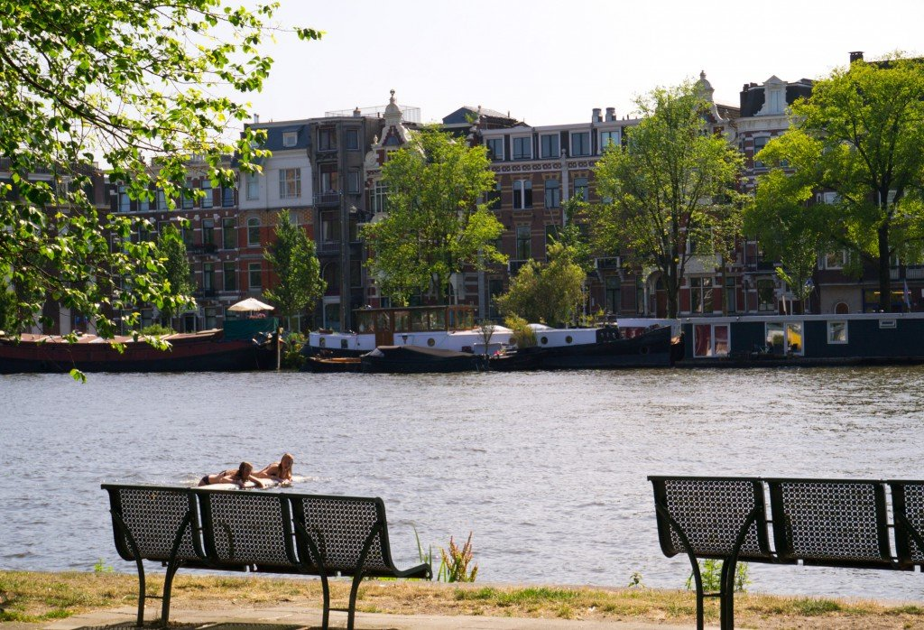 Girls chilling in the Amstel River on a hot day