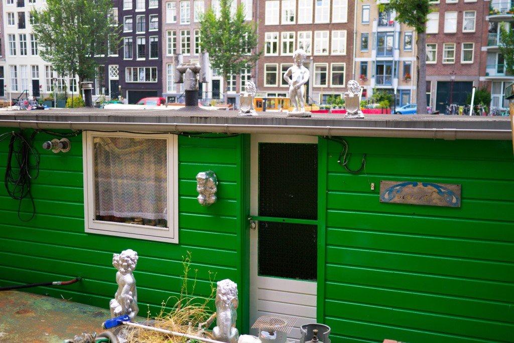 Manneken-Pis statue on a boat in Amsterdam